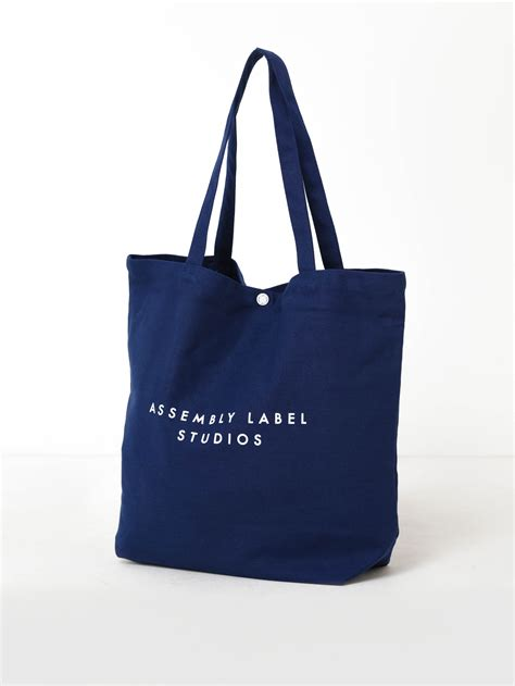Assembly Label Unisex Canvas Tote Bag in Navy